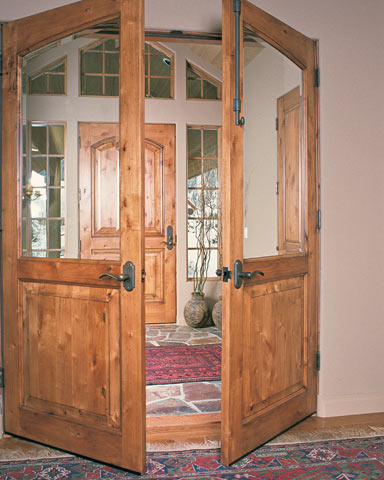 raised panel doors in entry and antechamber & Custom wood doors and millwork Pine Door Manufacturing Darby Montana